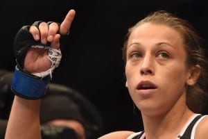 July 26, 2014; San Jose, CA, USA;  Joanna Jedrzejczyk celebrates her victory against Juliana Lima following the womenÕs strawweight bout of the FOX UFC Saturday at SAP Center. Mandatory Credit: Kyle Terada-USA TODAY Sports - RTR408HP